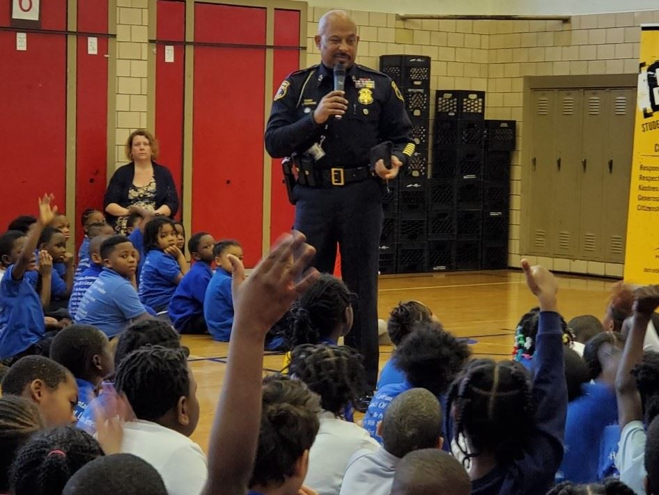 Office Godbee addressing students during an assembly