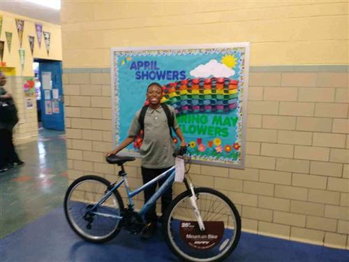 student winner with mountain bike
