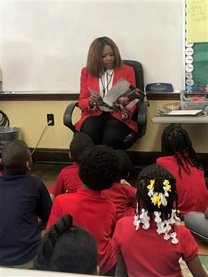Board member reading to students