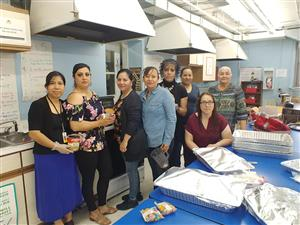 Parents and school staff helping prepare luncheon
