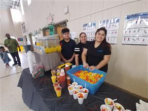 sponsors serving fruity treats