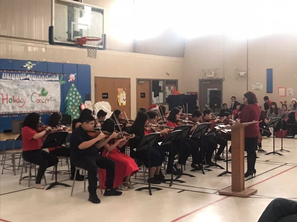 strings band performing at the holiday concert