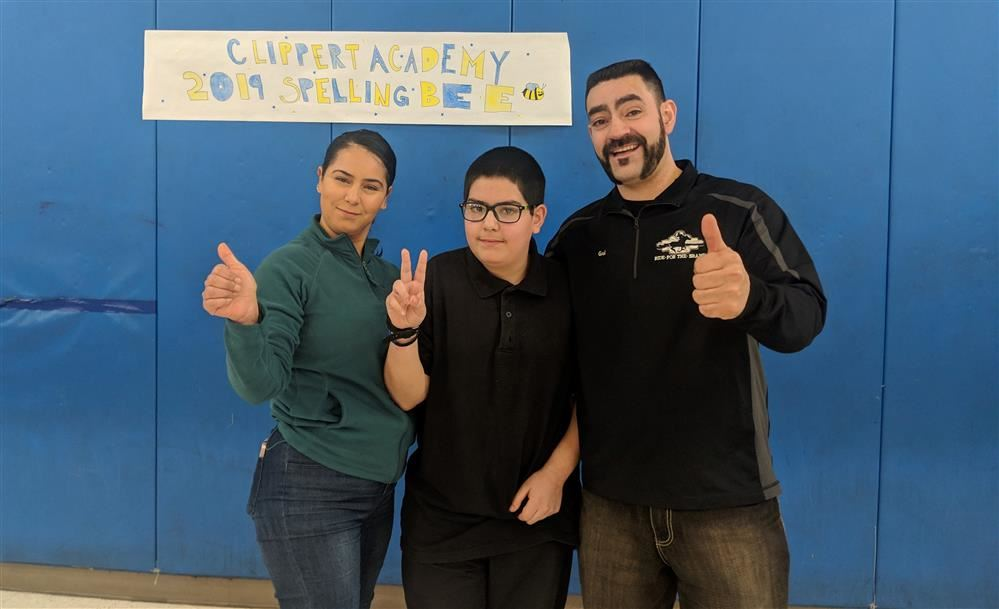 Spelling Bee winner Mauricio Trujillo with his parents