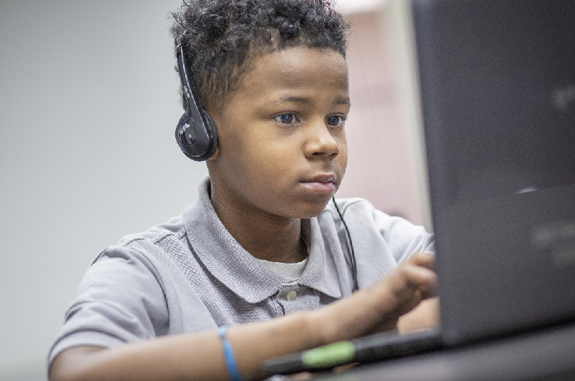A boy working at a computer