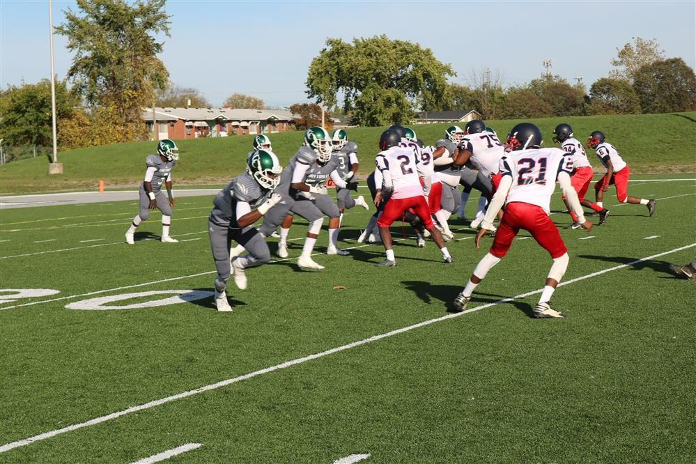 Cody football team running a play on the field