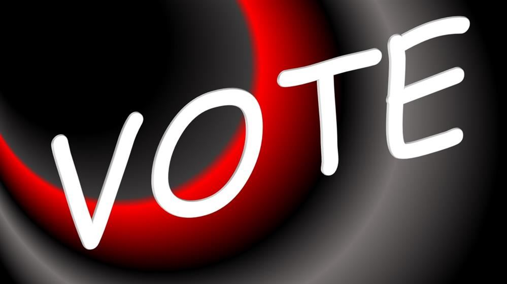 Image of the word vote, a black, red, and gray background