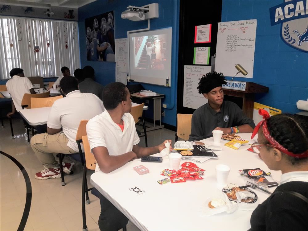Students enjoying food, snacks, games and a movie