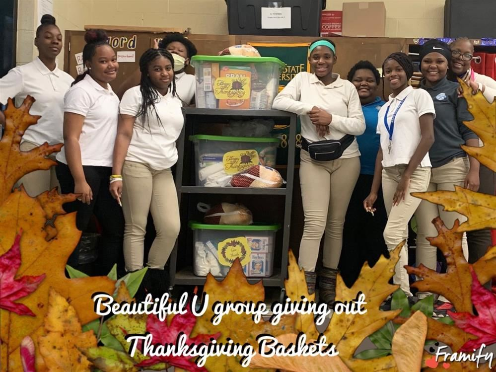 The Beautiful U girls group posing with the Thanksgiving baskets they made