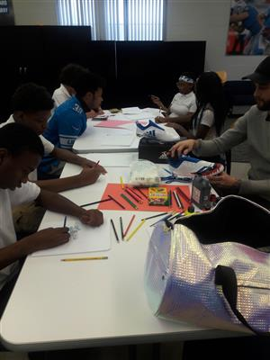 Students brainstorming their ideas with Jamal Agnew