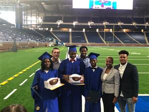 Scholarship winners, Selena Clark, Corday Clayton and Elijah Hills with members of the Detroit Lions Organization