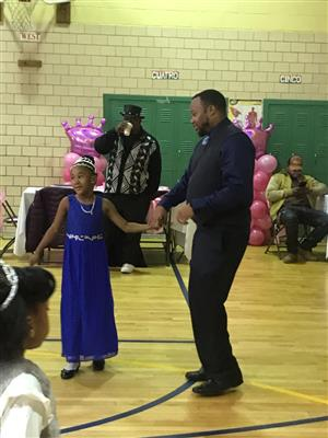 dad and daughter dancing in gym for daddy daughter dance