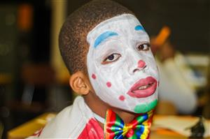 painted clown face kid