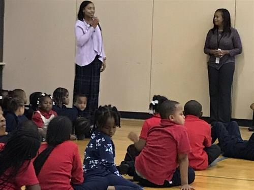 Ms. Washington holding assembly for students for expect respect.