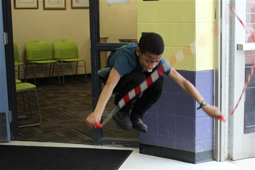 A student jumping rope during exercise time.