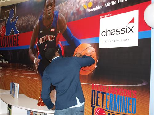 Reggie Jackson signing the wall in the media center.