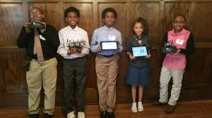Flics Students holding award certificates