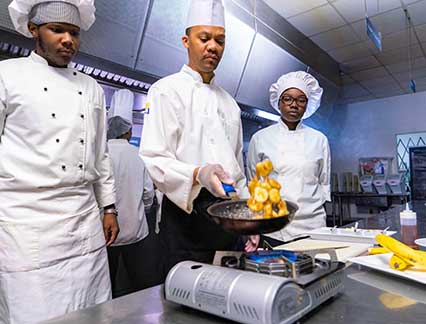 Cooking teacher with a male and a female student