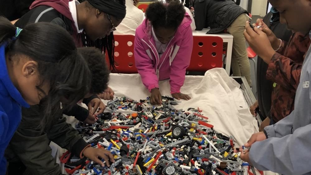Gompers students build robots for competition at the Robot Garage.