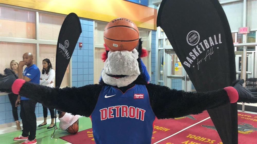 Detroit Pistons Mascot Hooper balancing a basketball on his nose