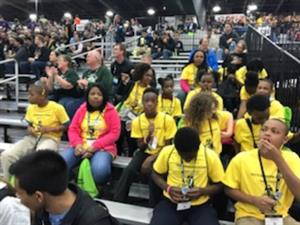 Robotics team watching an event