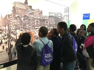 Hutchinson students viewing an image of old Detroit