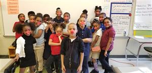 Second grade students with red noses