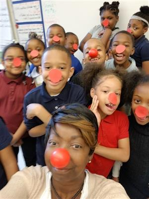 Teacher and students with red noses