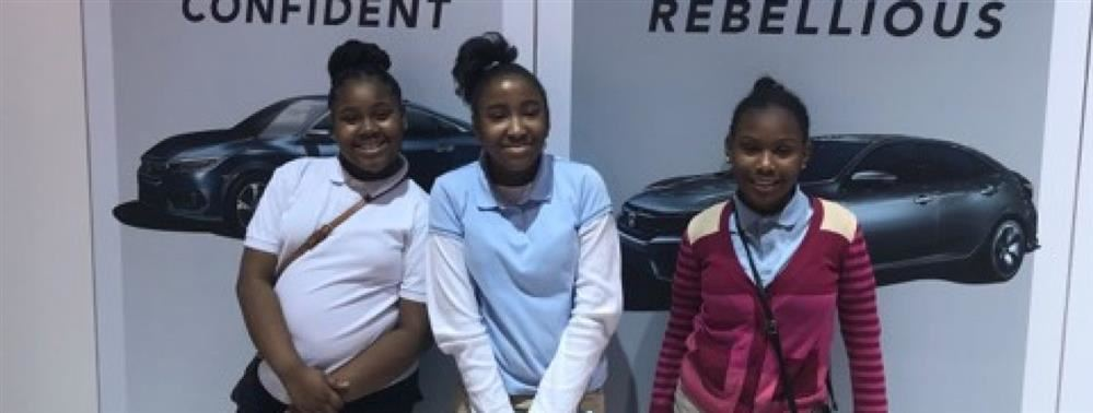 Hutchinson female students at Auto Show