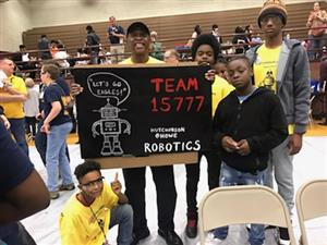 Hutchinson-Howe Robotics Team holding the team sign